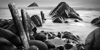 Rocks and misty sea